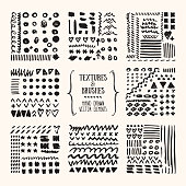 Hand drawn textures and brushes. Artistic collection of design elements, round labels, grunge lines, brush strokes, wavy lines, tribal backgrounds, geometric pattern made with ink. Isolated vector set.