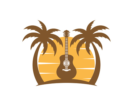 Guitar between the palm tree in the sunset beach