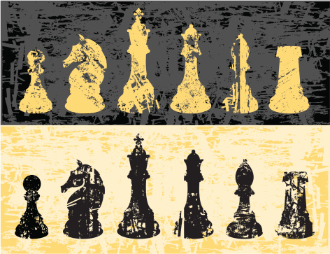 Dark and bright chessmen with grunge effect applied. The grunge effect has been cut directly into the shapes.