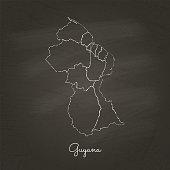 Guyana region map: hand drawn with white chalk on school blackboard texture.
