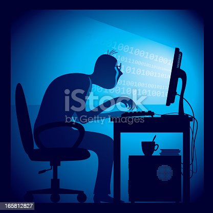 872006502 istock photo Hacker hard at work hunched over a keyboard 165812827