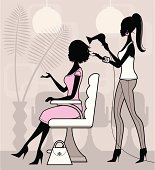 A cute female hairdresser drying a woman's hair. Click below for more spa and beauty images