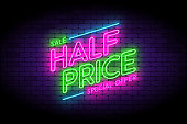 Half price, sale, premium offer neon sign on the wall. Vector illustration with realistic neon effect for shop promotions.