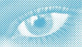 Illustration of a woman's eye close-up, in halftone dots retro style