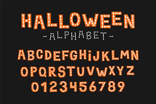 Halloween alphabet with skeleton bones. Type design for holiday party celebration.