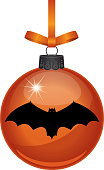 Vector illustration of an orange hanging glass ornament with a black bat on it.