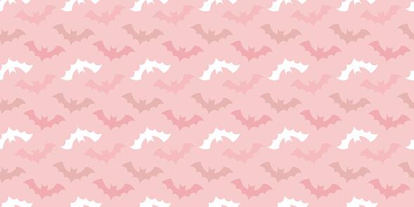 Halloween bat seamless repeat pattern pink background.