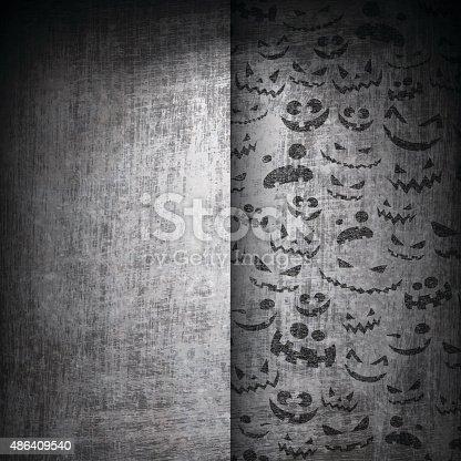 istock Halloween Faces on Grunge Background 486409540