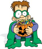 A small boy holding a pumpkin basket full of candy. By the look of his eyes it looks like he has eaten just a little bit too much sugar.