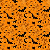 Halloween holiday. Seamless pattern with bats, spiders and cobwebs. Black silhouette on an orange background.