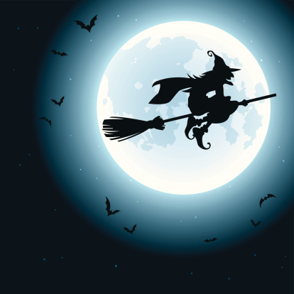 A Halloween image of a witch on a broom