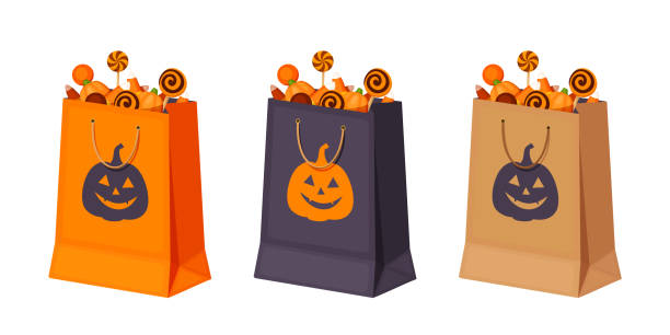 halloween paper bags with candies. vector illustration. - torba stock illustrations