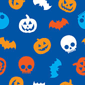 Vector illustration of multi-colored jack o lanterns, bats, and skulls in a repeating pattern against a blue background.