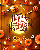 Halloween poster with big lamp look like the moon and Halloween Elements on wood background.Party Invitation Concept in Traditional Colors.Website spooky,Background or banner Halloween template