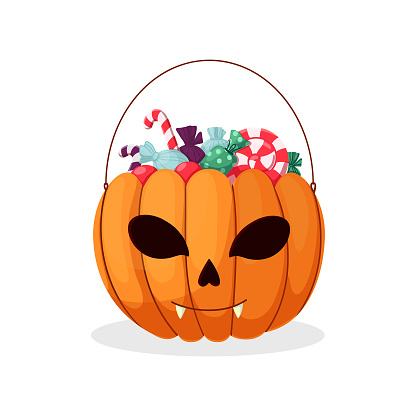 Halloween pumpkin. A basket in the form of a pumpkin with sweets and lollipops.