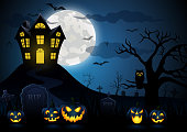vector illustration of Halloween pumpkin and spooky house with blue moon background