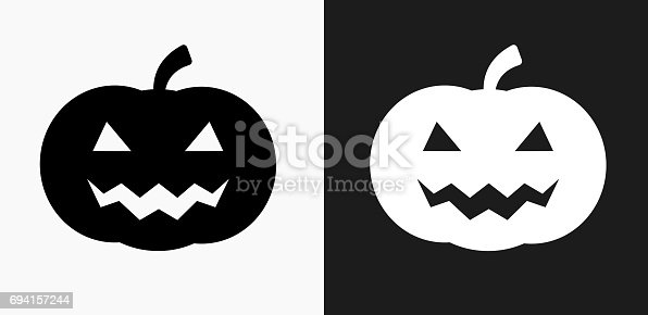 istock Halloween Pumpkin Face Icon on Black and White Vector Backgrounds 694157244