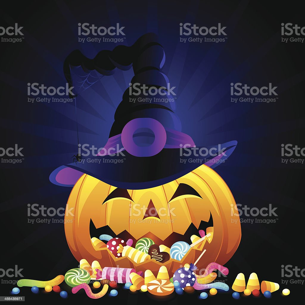 A Halloween pumpkin with candy