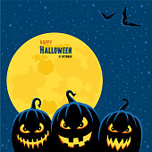 Happy Halloween message with full moon and pumpkins.