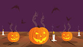 Helloween design with orange pumpkins with cut out glowing face