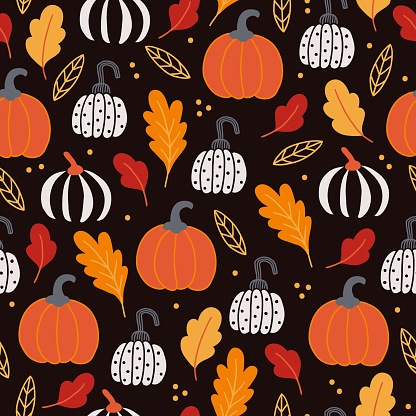 Halloween seamless pattern with colored pumpkins and oak leaves