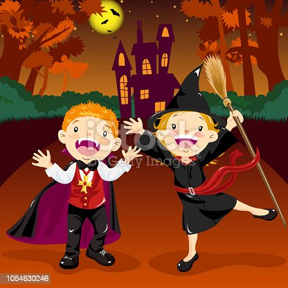 Kids dressing up Halloween vampire and witch costume to go trick or treating.