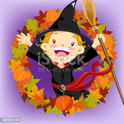 Little girl dress up witch costume stand inside the autumn leaf wearth.