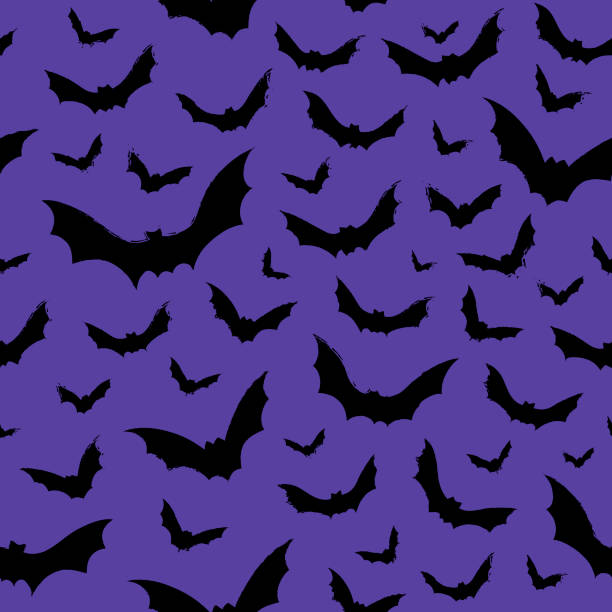 Hallowen pattern of flying bats Vector seamless background. Ready for printing on textile and other seamless design. flapping wings stock illustrations