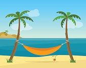 Hammock with palm trees on beach