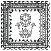 Hamsa hand drawn symbol in patterned frame. Mehndi style. Decorative pattern in oriental style. For henna tattoos, and decorative design documents and premises.