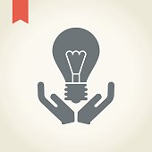 Hand and light bulb icon.New idea concept .