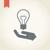 Hand and light bulb icon.New idea concept