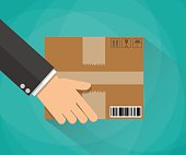 Hand carrying a cardboard box. delivery concept. vector illustration in flat design on green background with long shadow