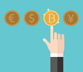 Hand of businessman pointing at and choosing gold shining bitcoin among euro, dollar and yen. Currency, finance and economy concept. Flat design. Vector illustration, no transparency, no gradients