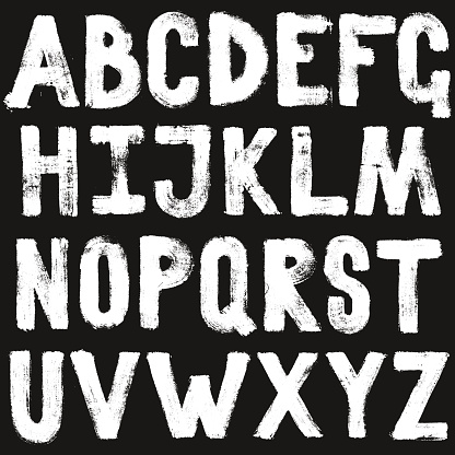 Hand drawing brush calligraphy texture of alphabet letters. Isolated vector set white on black