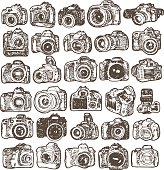 Hand drawing doodle sketching modern SLR photo cameras. Isolated vector elements