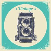 Hand drawing graphic strokes texture of old vintage two lens photo camera. Isolated vector illustration