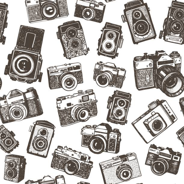 hand drawing retro photo cameras seamless pattern background - aparat fotograficzny stock illustrations