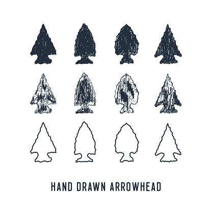 Hand drawn arrowheads vector illustrations set.