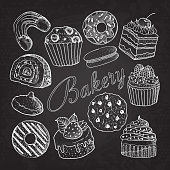 Hand Drawn Bakery Sweets Desserts Doodle on Chalkboard. Sketch Set with Cupcake, Cookie, Donut, Macaroon and Muffin. Vector illustration