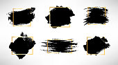 Hand drawn brush spots with golden frame set. Vector illustration. Black white paint stripes and strokes artistic backgrounds. Grunge texture scribbles frame, box or background for text