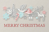 Hand drawn Christmas ornaments and icons made as cut out paper shapes.