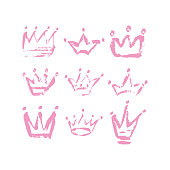 Hand drawn crown icon set in pink color. Ink brush crowns background for baby Princess