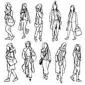Autumn women's fashion. Hand drawn girls on white background.Vector sketch illustration.
