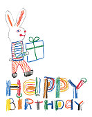 Creative crayon drawing. Happy birthday message with bunny and a gift