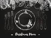 Hand drawn illustration of curly ornamental silver tableware, plate a black chalkboard background. Vector frame with hand drawn elements: branches of fir, cones, streamers, bell, bow, Christmas ball. Vector Illustration