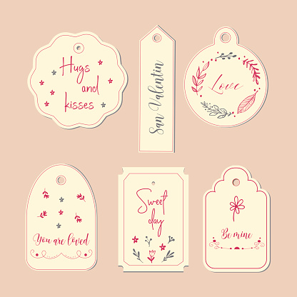 Hand drawn labels and tags. Elements collection for Valentine s Day.The main symbols of the holiday. Vector logo, emblems, text design. Usable for banners, greeting cards, gifts etc