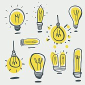Vector illustration of a set of hand drawn light bulbs in a cartoon style