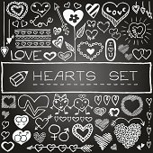 Hand drawn set of hearts and arrows with chalkboard effect. Vector Illustration.