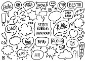 Vector collection of sketched speech bubbles and comic balloons and effects on a white background